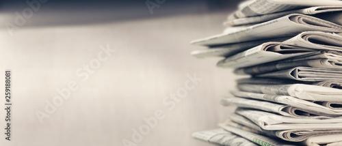 Fototapeta Pile of newspapers on white background obraz