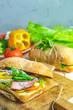 Italian porchetta sandwich with ham, tomato, cheese, pepper, onion and salad