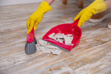 Clean Up Broken Plate With Broom And Dustpan