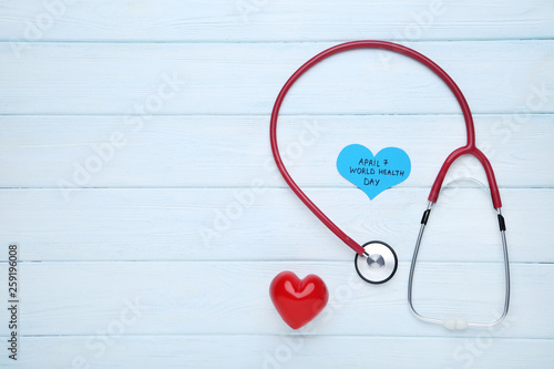 Fotografia  Text April 7, World Health Day with stethoscope and red heart on wooden table