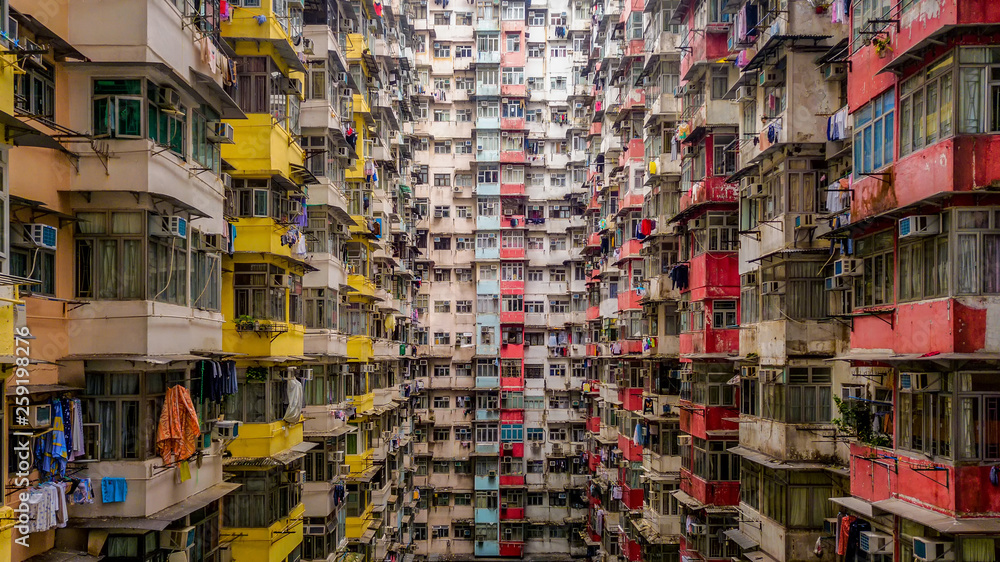 Fototapeta Aerial view of Yick Fat Building, Quarry Bay, Hong Kong. Residential area in old apartment with windows. High-rise building, skyscraper with windows of architecture in urban city.