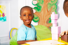 Little Boy Building Blocks In Nursery School