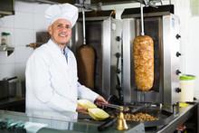 Mature Man Cook Wearing Uniform Preparing Kebab