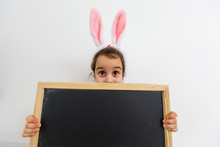 Little Girl Playing Baby On Easter Egg Hunt Kids Play . Heart Form Blank Chalk Board For Your Text