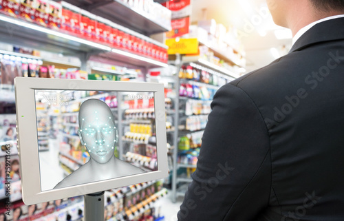 Obraz Smart retail in futuristic use iot technology concepts. Customer use facial recognition application to login to system to buy,search special price product for security reason with face payment. - fototapety do salonu