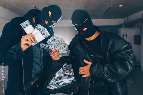 Fotografie, Obraz  Young stealers holding money