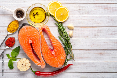 Two fresh Salmon steaks with seasonings and spices close-up