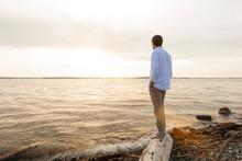 Man Standing On Beach Looking ...