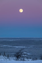 Full Moon Over Snowy Landscape