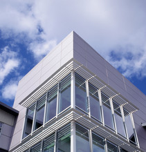 Modern Office Building Exterior Windows With Louvered Solar Sun Shades. Green, Energy Efficient Architecture.