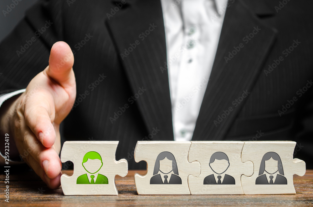 Fototapeta A businessman joins a new employee to the team as its leader. Hiring new employees for the project., teamwork. leader works with the team as a member. increasing efficiency, confidence, communication
