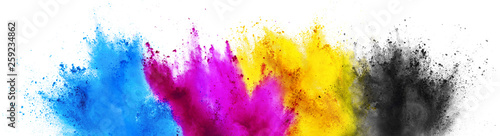 Photo  colorful CMYK cyan magenta yellow key holi paint color powder explosion print co