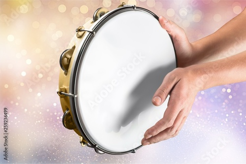 Fotomural Female hands Playing the tambourine on background