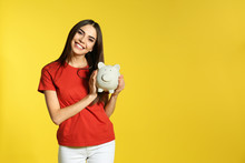 Young Woman With Piggy Bank On...