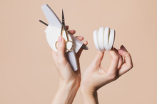 Woman Holding Manicure Accessories