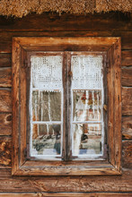 Rustic Window In Wooden Village Cottage House. Grunge Weathered, Abandoned Brown Wood Wall Background.
