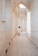 Woman In White Dress Running Down The Hallway