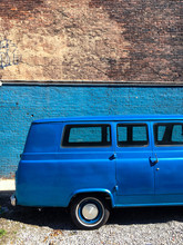 Blue Retro Van On Blue Wall