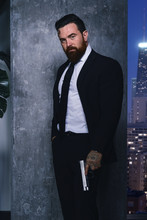 Male Assassin In Suit Holding ...