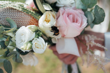 Wedding Bridal Bouquet In The Rustic Style On Which The Bee Sits