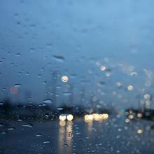 Abstract City Lights Through A Rainy Car Windshield