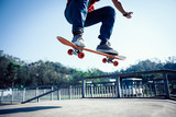 Skateboarder skateboarding at skatepark ramp