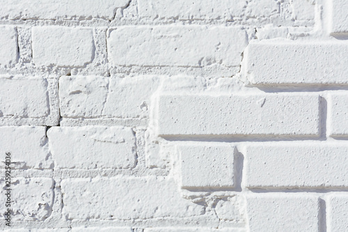 Old brick wall painted white - 259254036