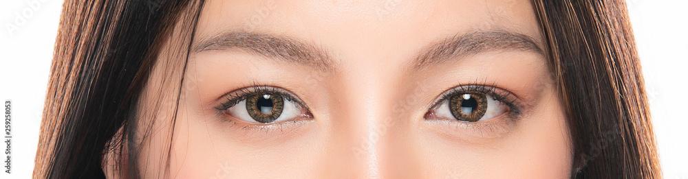 Fototapeta Close-up Asian Women's eyes on White Blackground.