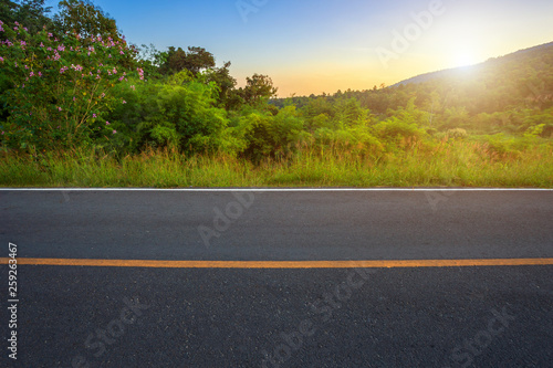 Poster de jardin Route dans la forêt Rural road with Scenic view of the reservoir Huay Tueng Tao with Mountain range forest at evening sunset in Chiang Mai, Thailand