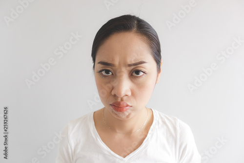 Sulk and grumpy face expression of woman in white t-shirt Canvas-taulu