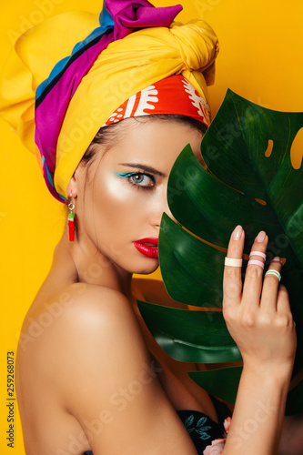 girl with tropical leaf