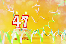 Forty Seven Years Birthday. Cupcake With Burning Candles In The Form Of Number 47. Bright Yellow Background With Copy Space