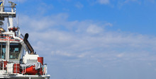 Captain's Bridge On The Ship. Tug Is At The Pier In The Sea Port. Panoramic View.