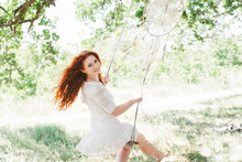 Young Red Hair Woman Holding White Dream Catcher