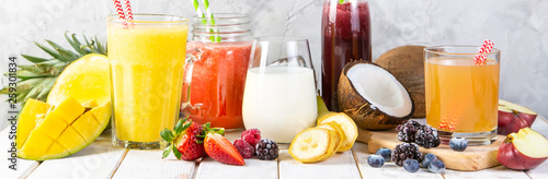 Poster Sap Selection of colourful smoothies in glasses with ingredients