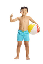 Little Boy In Swimming Shorts Holding A Beach Ball And Showing Thumb Up