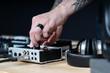 Dj man creates electronic music in the studio