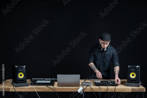 Dj man creates electronic music in the studio - 259308079