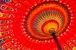 Leinwanddruck Bild - Detail shot of a red umbrella in Bali, Indonesia