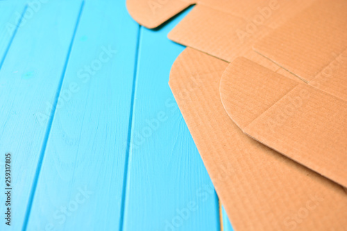 Valokuvatapetti Unwrapping cardboard package box background, copy space