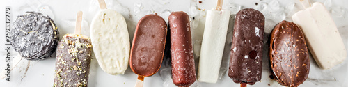Valokuva  Assortment of various popsicle ice cream, vanilla and chocolate, with nuts, on a
