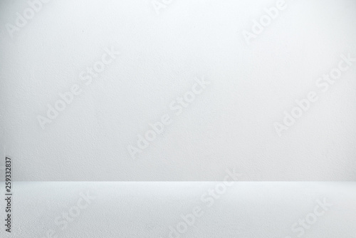 Fotografie, Obraz  Cement wall with floor in the empty room and light for background