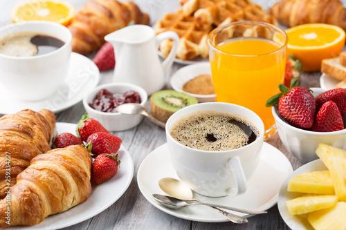 Fotografie, Tablou Continental breakfast table with coffee, orange juice, croissants