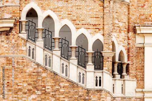 Photo  Lancet windows with staircase, architectural detail of old colonial style building Bangunan Sultan Abdul Samad, Sultan Abdul Samad Building