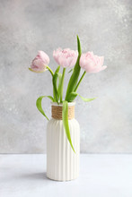 Pink Tulips In Vase On Grey Background