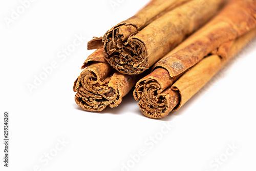 Isolated raw organic cinnamon sticks (Cinnamomum verum) from Sri Lanka Fototapeta