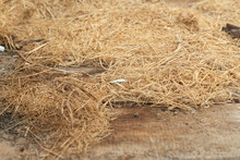 Dry Hay On A Wooden Background