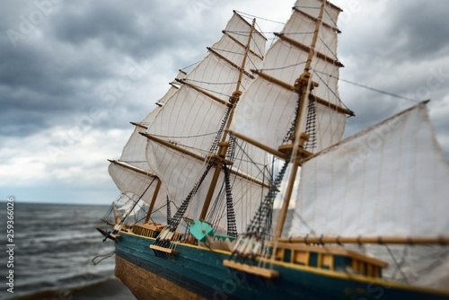 Scale model of a wooden sailing ship on the coast of the Baltic Sea on a cloudy spring day © Alex Stemmer