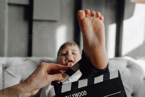 Fotografía  Caucasian Funny Boy Play with Cinema Clapper Board