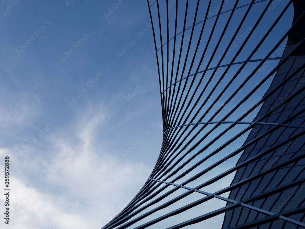 Fototapety, obrazy: 3D stimulate of high rise curve glass building and dark steel window system on blue clear sky background,Business concept of future architecture,lookup to the angle of the corner building.
